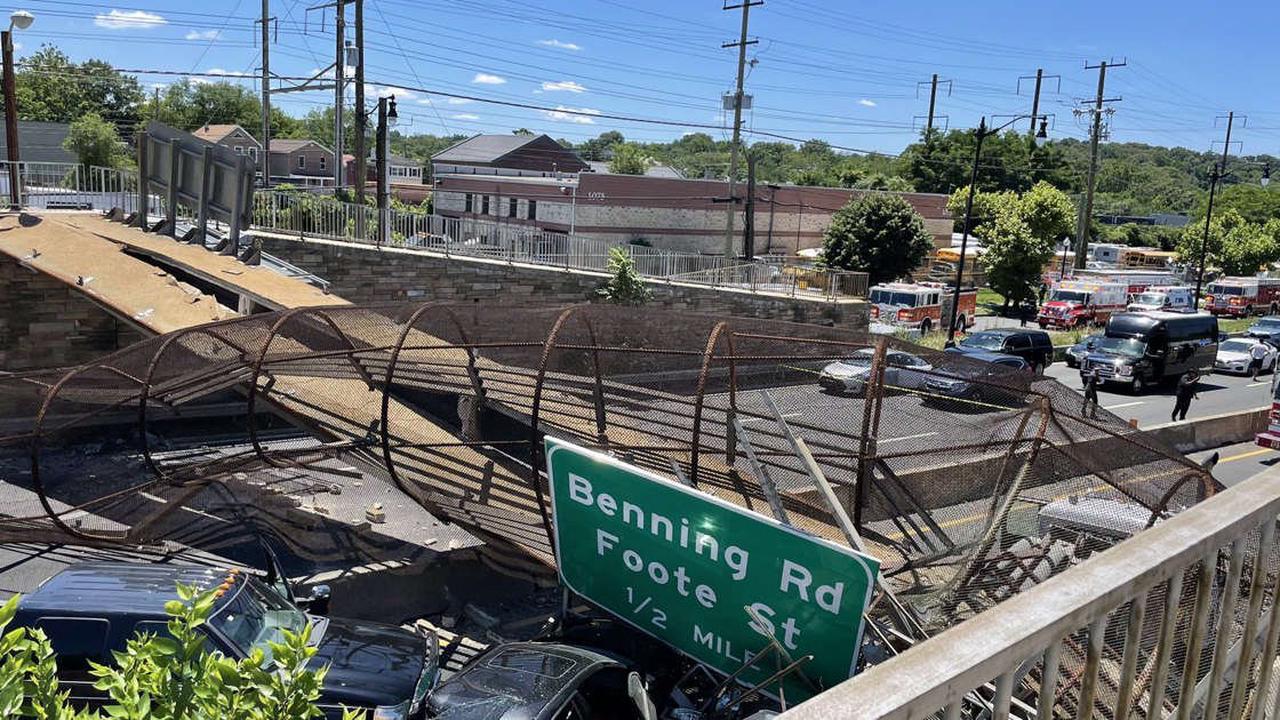 Several injured after pedestrian bridge collapses onto Washington D.C. highway