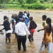 Sane Parents Help Kids Cross The Overflowing River As They Go To School: Bridge Swept Away