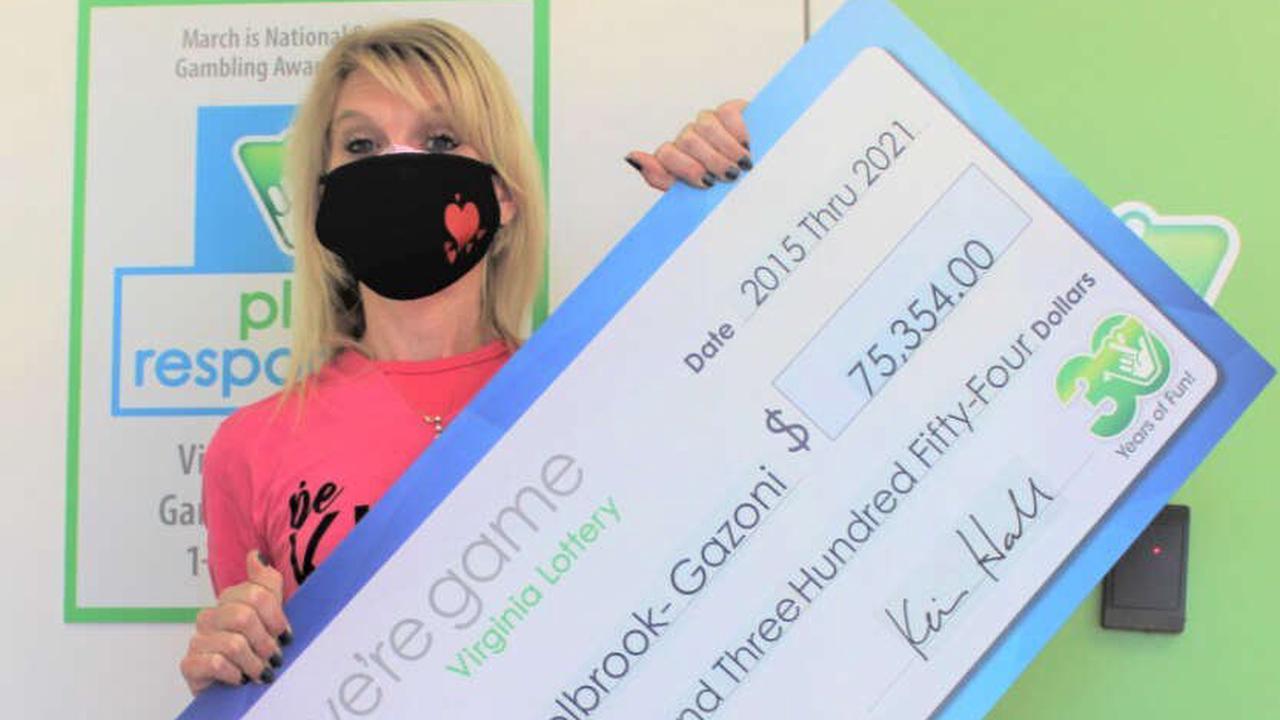 Henrico pediatric nurse receives souvenir check for lottery winnings