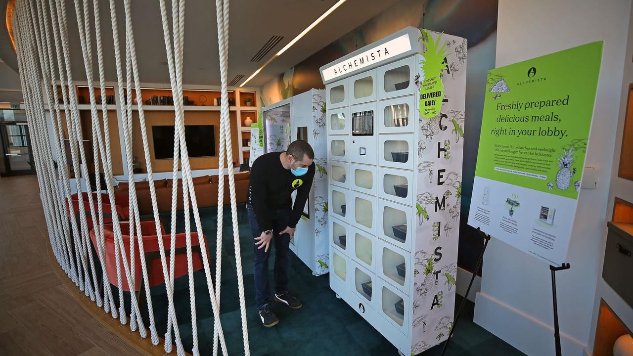 Apartment buildings are bringing work perks home by putting food lockers in the lobby