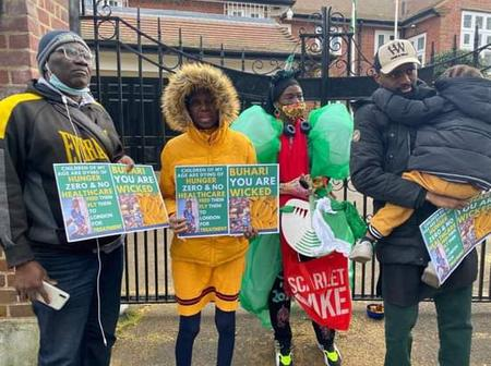 Pictures: See How Nigerians In London Stormed Abuja House With Placards Saying