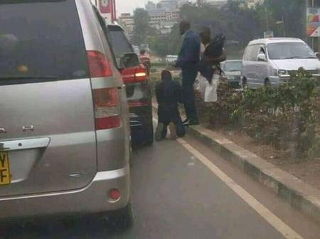 A Man Down On His Knees  Begs For Forgiveness After Hitting Benz With Toyota Noah