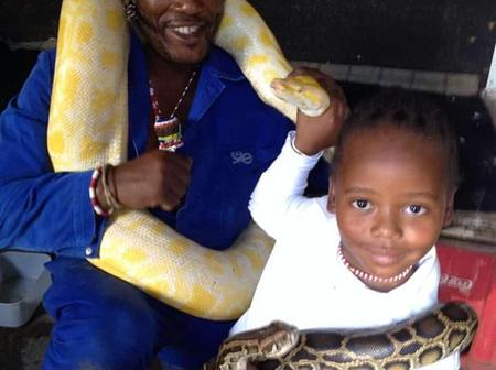 See What This Sangoma Uses His Snakes For.