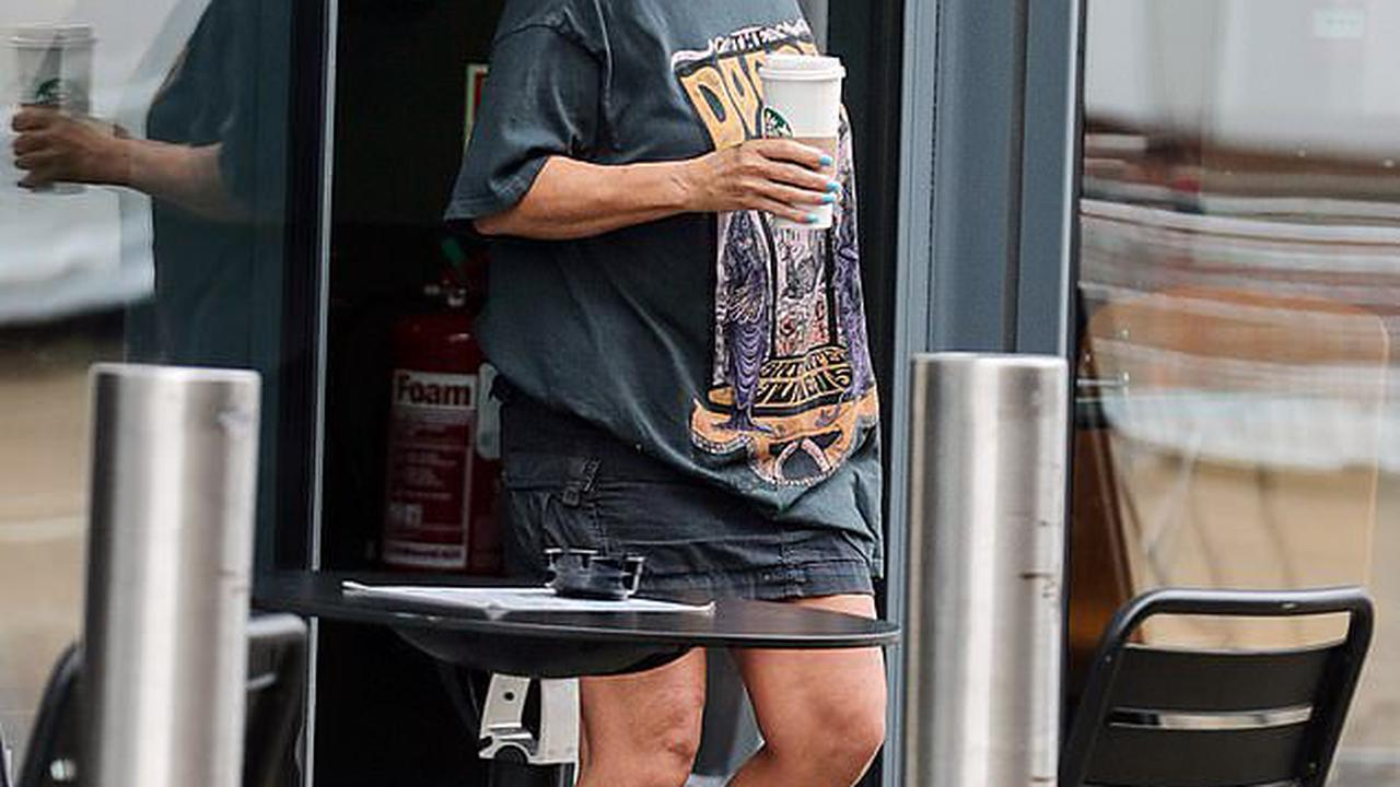 EastEnders' Jessie Wallace cuts a casual figure in a baggy T-shirt and fluffy slippers as she grabs a coffee ahead of a day of filming