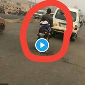 Man Spotted Carrying Baby On His Back While Riding His Bike