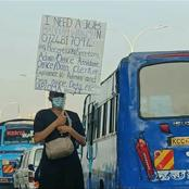 Hard Times in Kenya as Unemployed Woman Begs For Job With Placard Along Super Thika Highway (Photo)