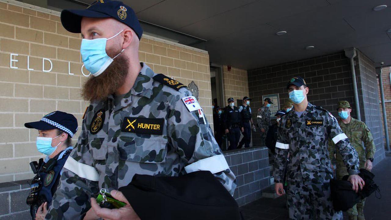 Covid curbs tightened as Brisbane extends lockdown, army patrol Sydney
