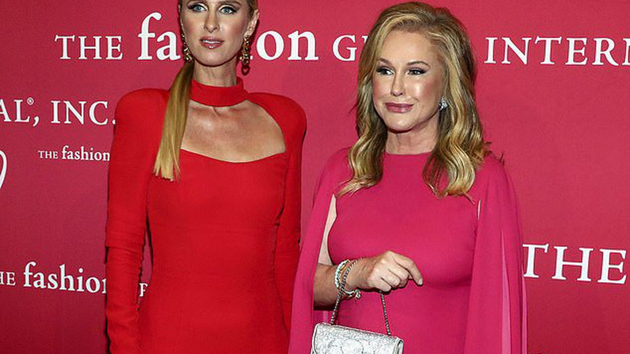 Nicky Hilton brings the glamour in a red floor-length gown as she cozies up to mom Kathy at FGI's annual Night of Stars gala in NYC