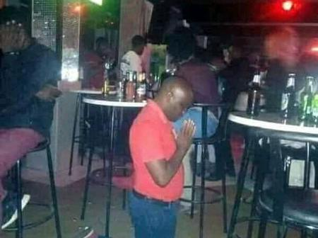 A Man in a Nightclub Kneeling Down Paying Respect To the Ancestors