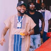 Mixed reactions as video of Davido holding a strange woman leaks