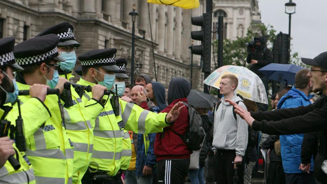 Police officers injured and 14 arrests made during anti-lockdown protest