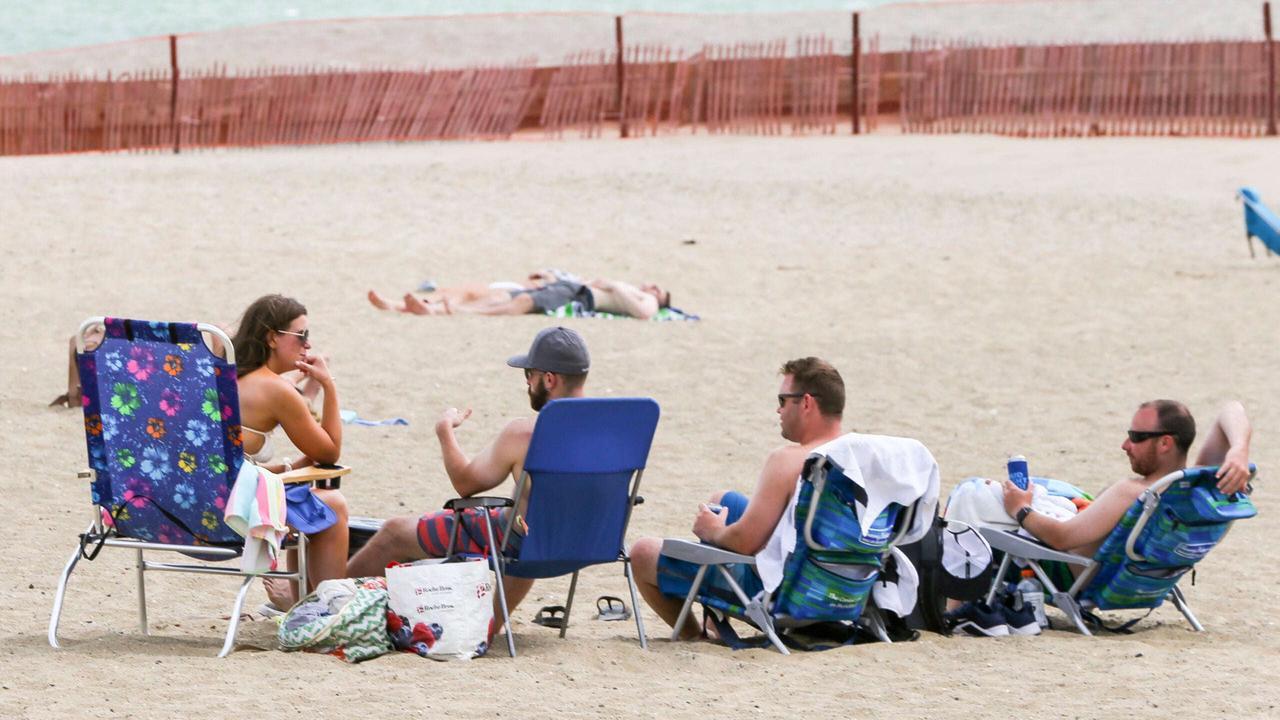 Officials increase M Street Beach patrols after complaints of liquor deliveries