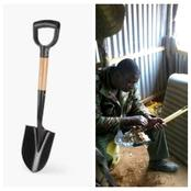 Man in Army Uniform Eats With Shovel, No Matter The Hunger Would You Do This?