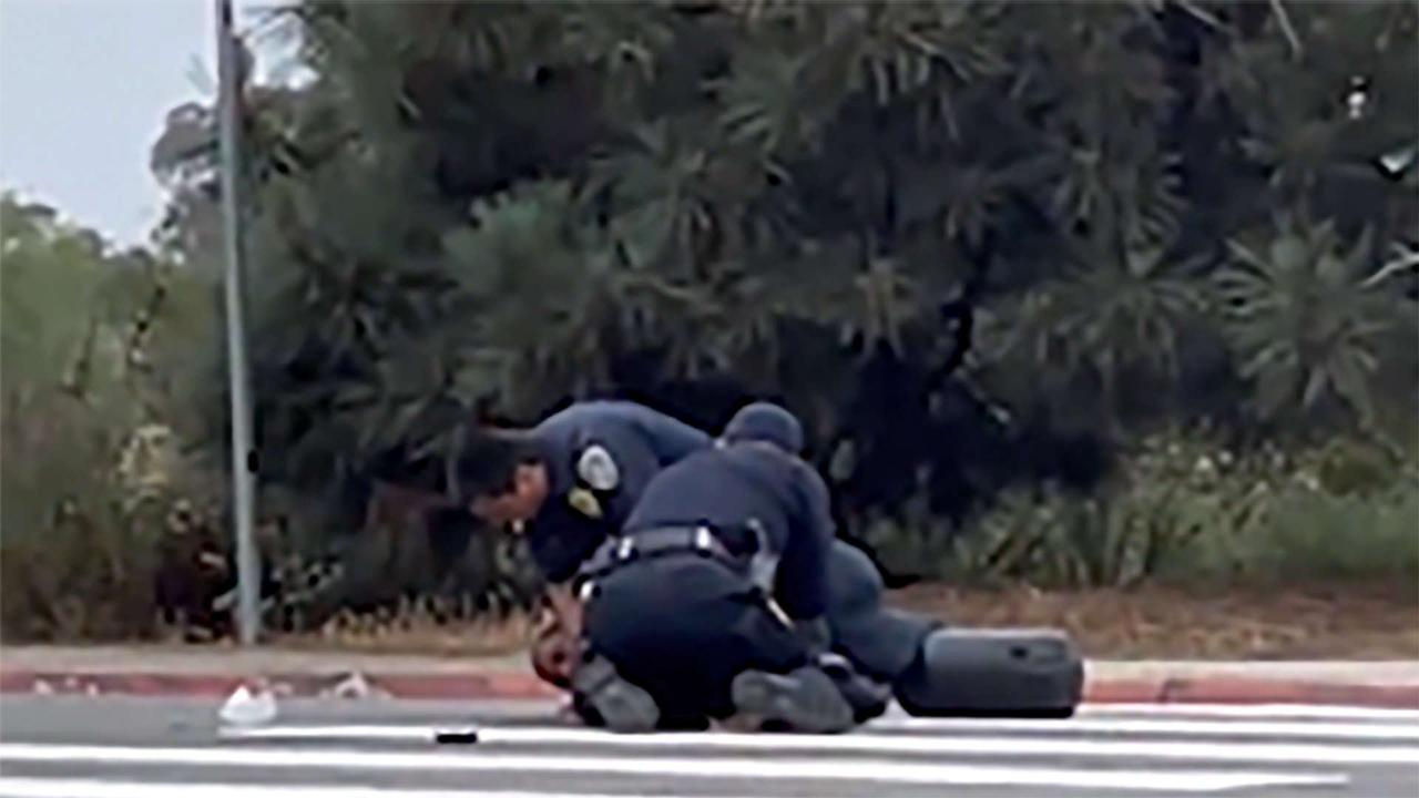San Diego police investigating after officers seen repeatedly punching Black man during arrest
