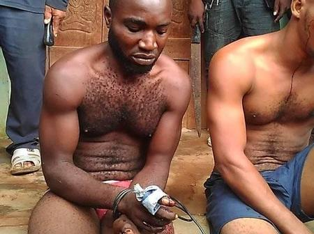 See Photos of 2 Young Men Caught With A Pistol By A Vigilante Group in Abia State