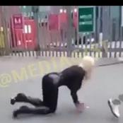 Watch: White Lady Seen Walking On Her Knees and Barking Like a Dog With Rope On Her Neck (Video)