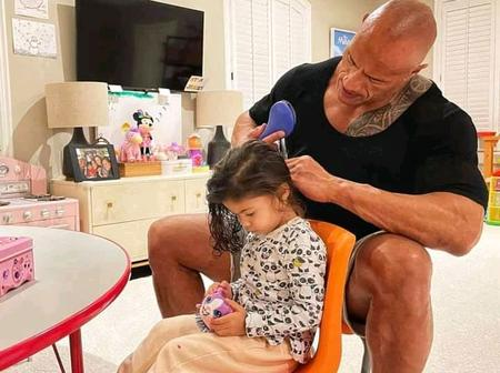 Moment Dwayne Rock was spotted plaiting his daughter's hair