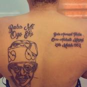 Checkout Viral Photos Of A Lady Who Tattooed Asiwaju Bola Tinubu On Her Back.