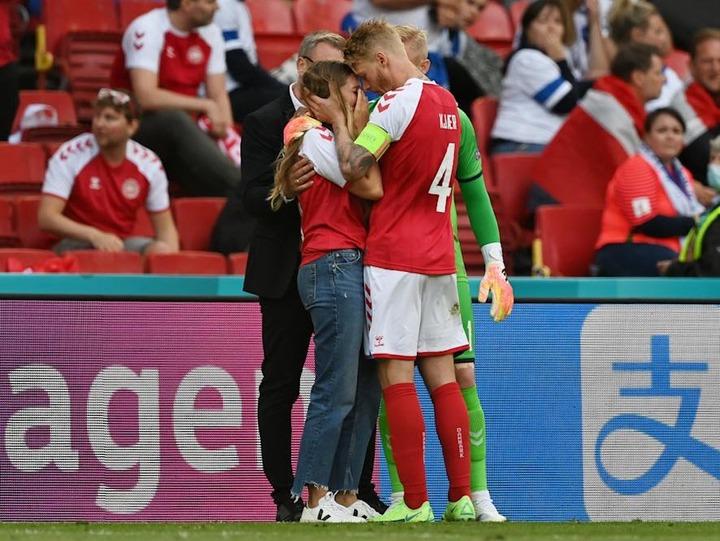 Simon Kjaer consoles Eriksen's distressed wife
