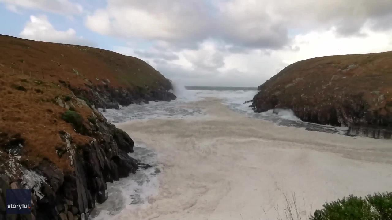 Sea Foam Accumulates on Irish Coast Following Storm Bella