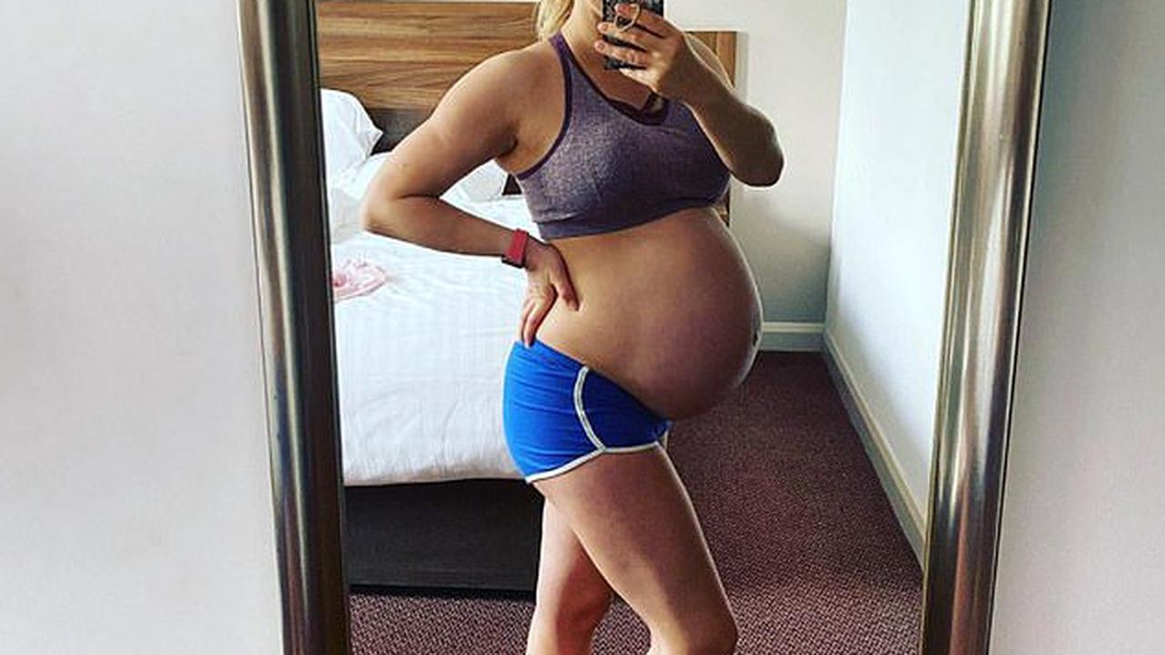 'Week 38': Pregnant Carley Stenson cradles her baby bump as she poses in sports bra and tiny blue shorts for post-workout snap
