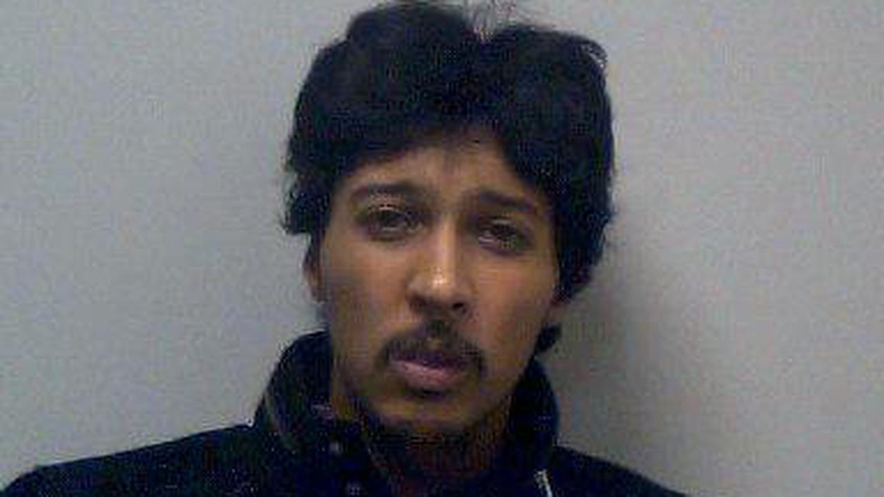 Thug who held knife to woman's throat in her own kitchen is jailed