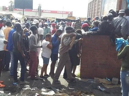 Police using force against the public who were queuing for Covid19 grants.