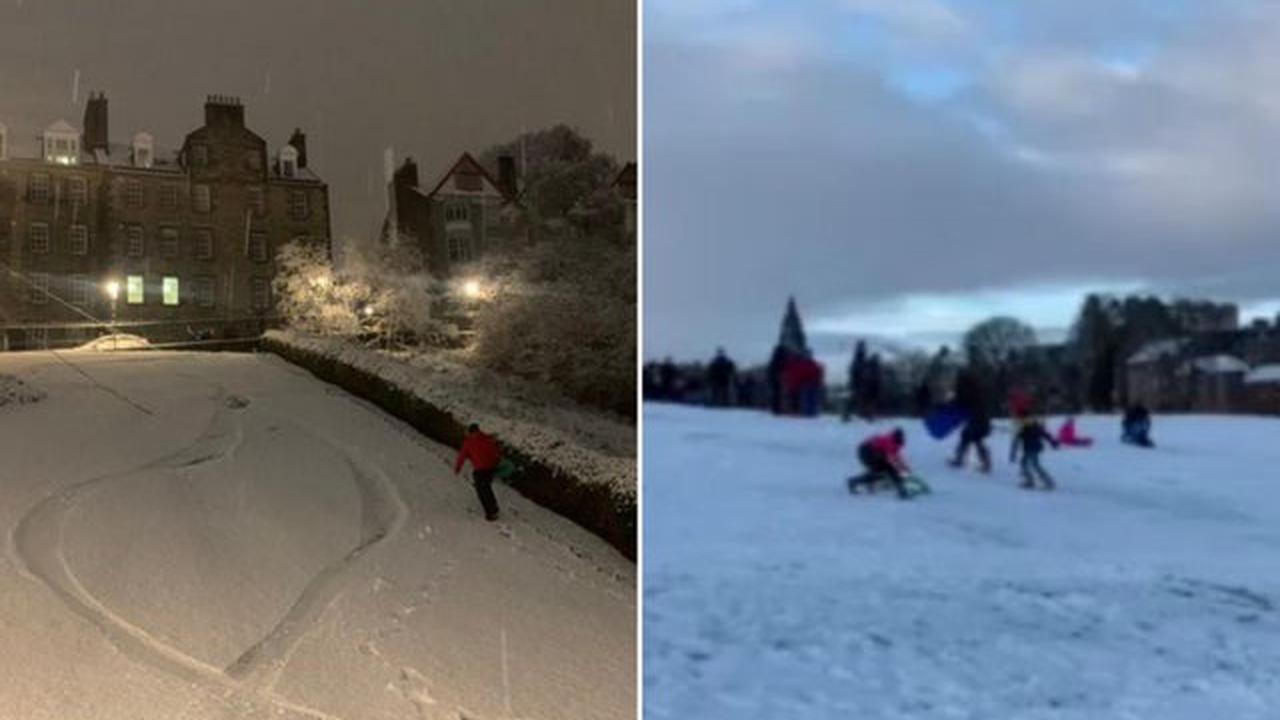 Watch as sledgers and snowboarders take to the street as locals delight in winter wonderland