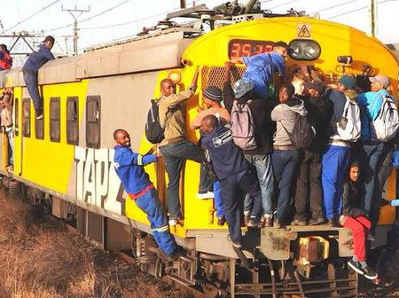 Here is passengers of train risking their lives for free trips. The issue becomes a huge problem.