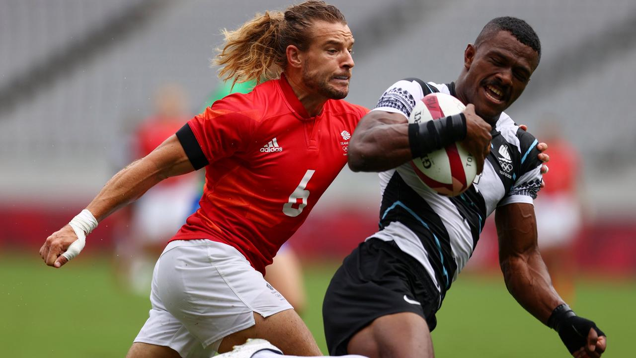 Tokyo 2020: GB hammered by Fiji in rugby sevens but still qualify for QFs
