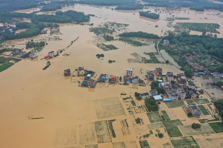 Many killed and thousands displaced as floods and rainstorms hit China  (Photos)