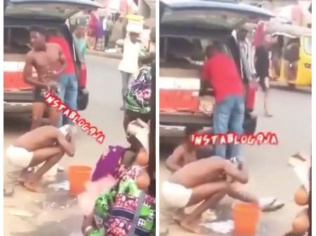 Reactions as 2 suspected Yahoo boys get beaten for taking their bath in  market