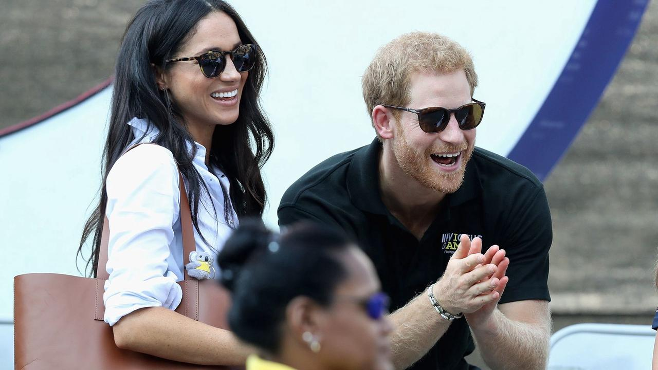 'Why bother posting this at all?' Royal fans bemoan not seeing Archie's face AGAIN as Meghan Markle and Prince Harry share a new photo of their son facing away from the camera for his second birthday