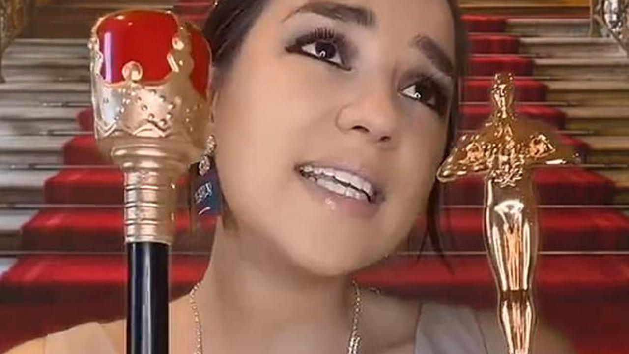 TALK OF THE TOWN: Social media satirist Meggie Foster posesin a pair of earrings bearing the Saudi flag as she repeats lyrics from The Little Mermaid in a take-down of Meghan Markle's interview with Oprah