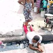 Mixed Reactions as a Man Lies Across a Gutter for His Pregnant Wife to Cross Over in a Photo Shared