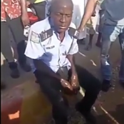 Reactions After Gun Of A Drunk Police Officer Was Seized While They Pour Water On His Head To Revive