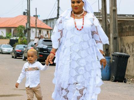 Nkechi Blessing steps out with her son