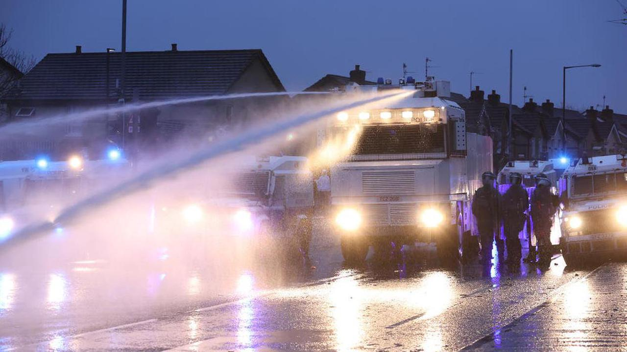 Police blast crowds with water cannon as violence flares again in Belfast