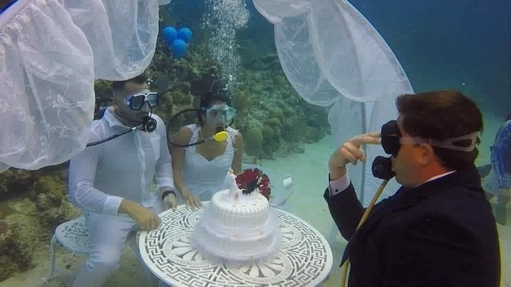 6fd9749996f31fdd6ced7a6874cea2fb?quality=uhq&resize=720 - See Photos Of A Couple Who Had Their Wedding Under The Sea To Prevent Any Distractions(Photos)