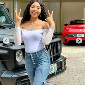 Check out reactions after Regina Daniels poses in front of a black Jeep in new photos