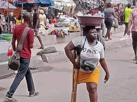 Inspiring Photos of Young Nigerian Woman Hawking Pure Water in Lagos Despite Having Just One Leg