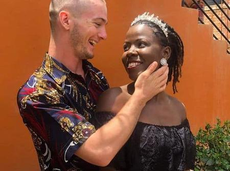 LOVEBIRDS!!! Black Lady And Her White Man Trek Back Home After Their Wedding (Photos)