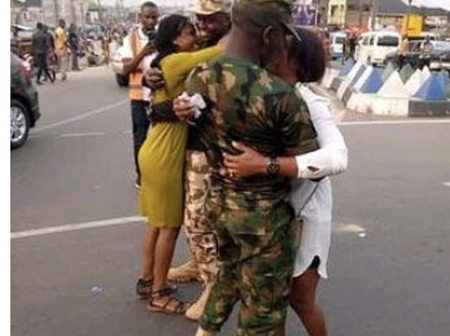 Checkout What Soldiers Were Seen Doing To These Two Ladies On The Street As People Watch Them