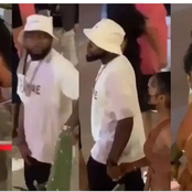 Reactions As Davido Was Seen Stepping Out With Another Women On His Vacation