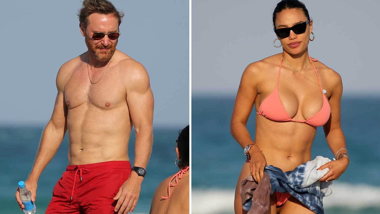 David Guetta, 53, and his girlfriend, 28, show off their six-packs in Miami