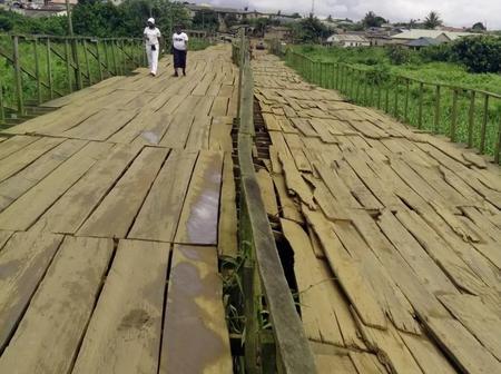 VIDEO: Man Laments as he drives through wooden bridge in Lagos