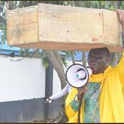 Mixed Reactions, As Lagos Based Pastor Carries Coffin, Says God Is Not Happy With Buhari's Govt.