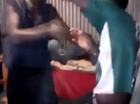 Family Drama As a Lady beats up husband Mercilessly in front of their children