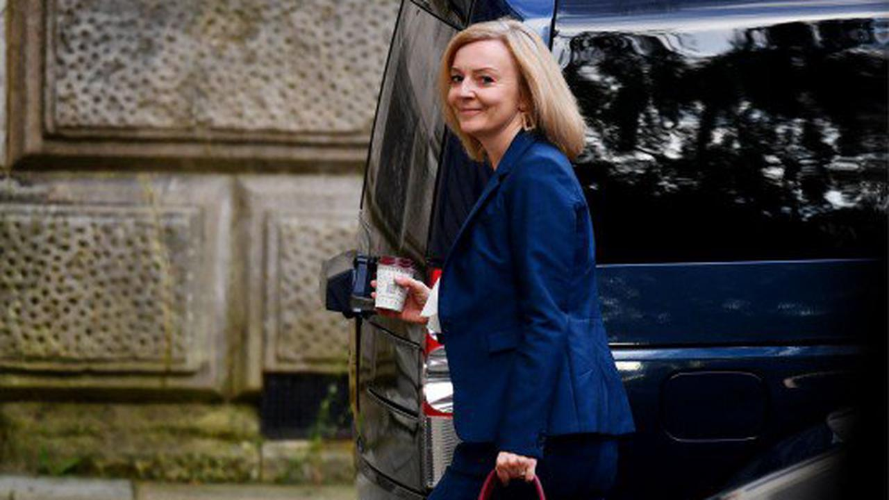 Liz Truss has big smile on her face as she arrives for first day as Foreign Secretary