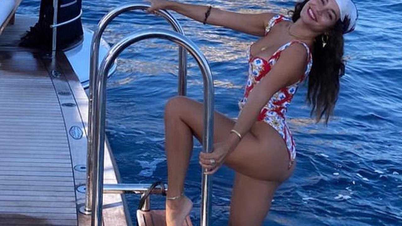 Vanessa Hudgens shows off her incredible figure in a floral swimsuit as she frolics on a yacht in Italy